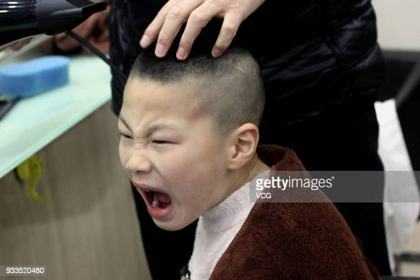 A boy gets a haircut on the Longtaitou Festival on March 18 2018 in Nanjing Jiangsu Province of China As a traditional custom Chinese people get a...