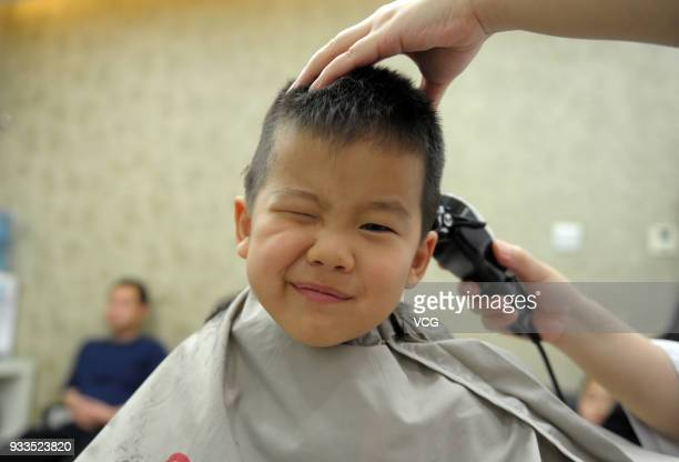 A boy gets a haircut on the Longtaitou Festival on March 18 2018 in Beijing China As a traditional custom Chinese people get a haircut to pray for...