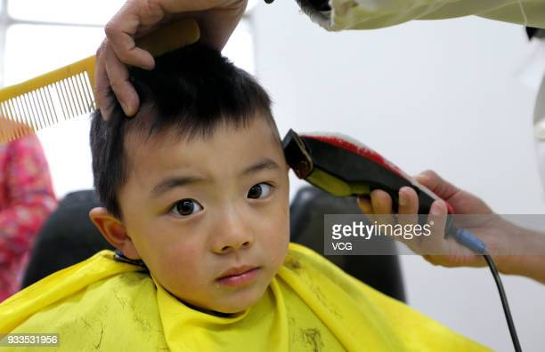 A boy gets a haircut on the Longtaitou Festival on March 18 2018 in Lianyungang Jiangsu Province of China As a traditional custom Chinese people get...