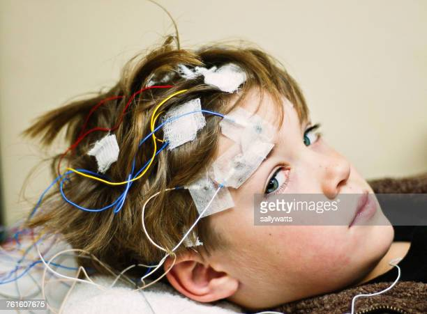 boy getting an eeg - eeg stock pictures, royalty-free photos & images