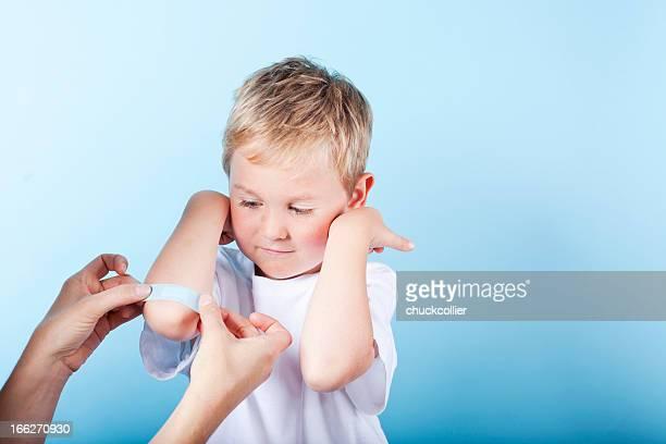 Boy Getting Band-aid