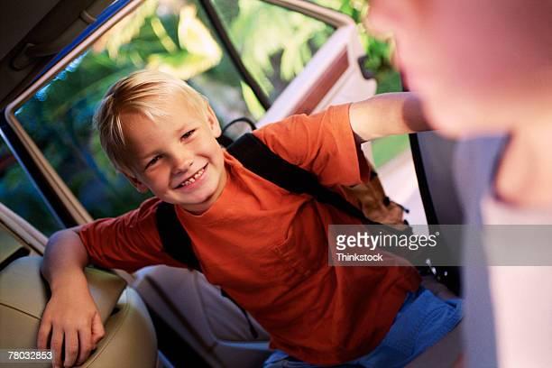 Boy getting in car