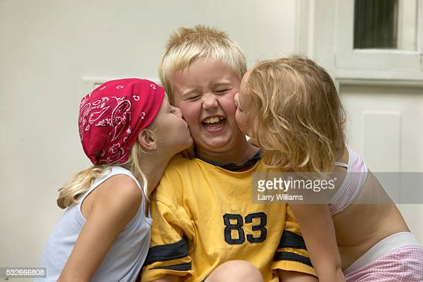 Boy Getting Kissed by Girls