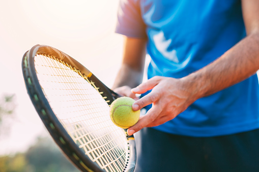 Boy getting ready for a serve in tennis. 1058724316