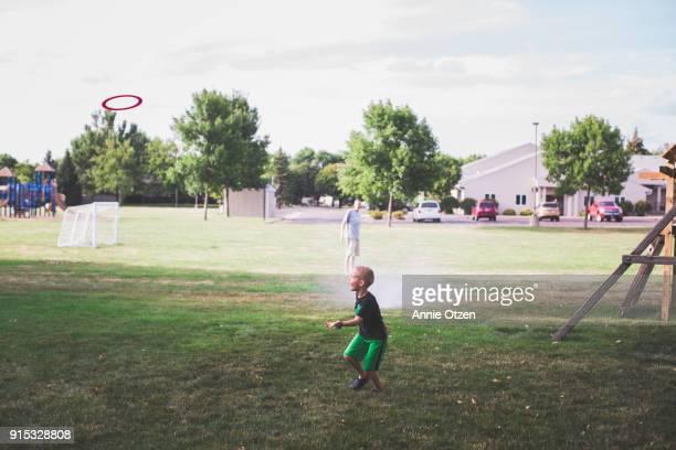 Boy getting ready to catch frisbee