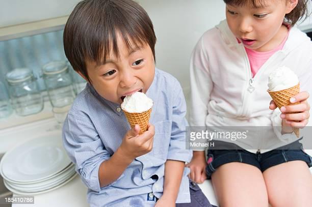 boy & girl eating icecream in the kitchen