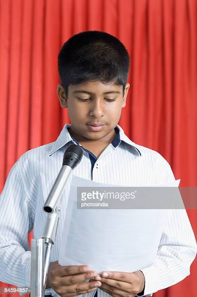 Boy giving an speech on a stage