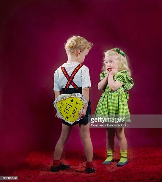 boy giving girl valentine card - little girls giving head stock photos and pictures
