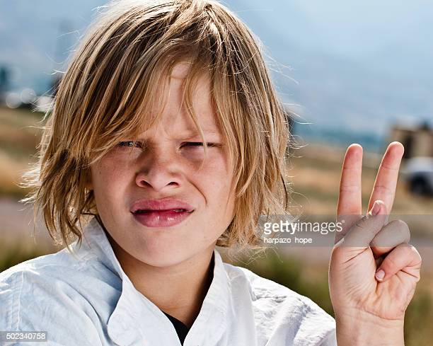 Boy Giving the Peace Sign