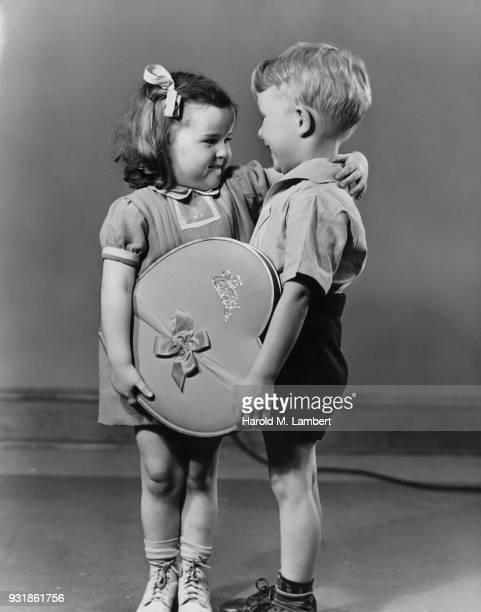 Boy giving Valentine present to girl