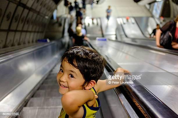 Boy going down an escalator