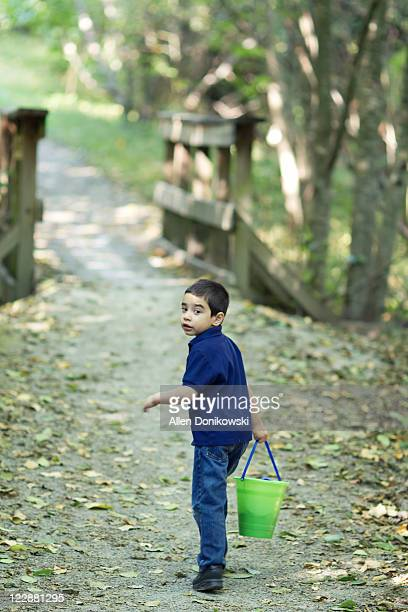 Boy going into forest