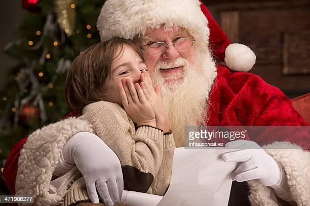 Boy going over naughty nice list with Santa