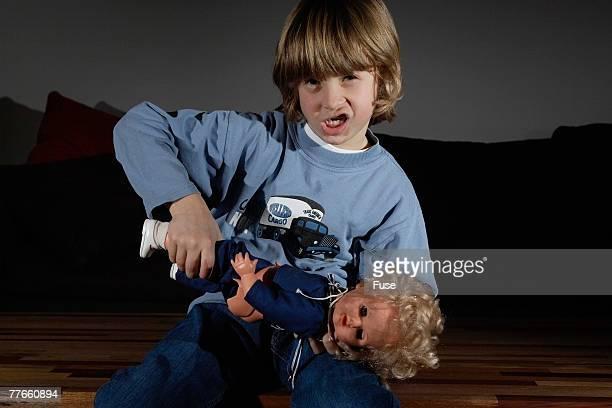 Boy Grabbing Doll