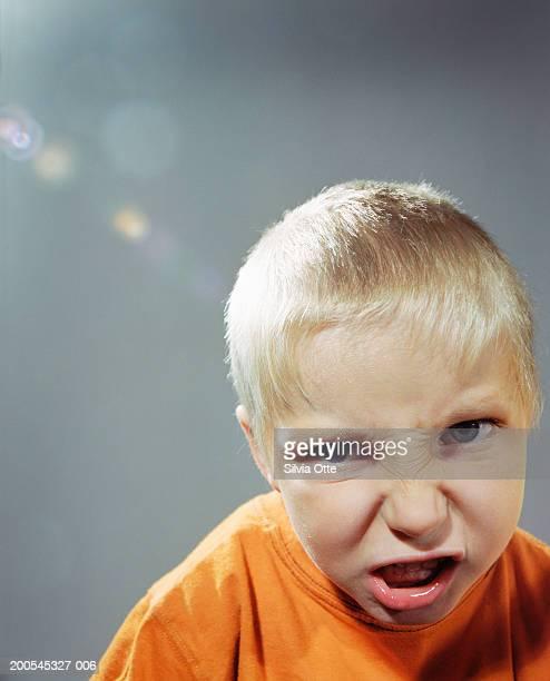 Boy (4-5) grimacing, portrait, close-up