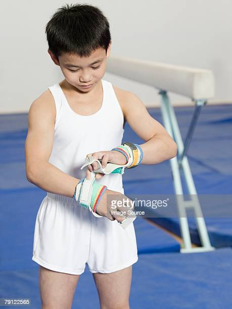 Boy gymnast with hand protection