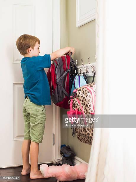 Boy (8-9) hanging his school bag, Los Angeles, California, USA