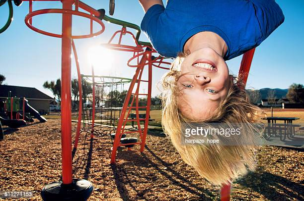 Boy hanging upside down.