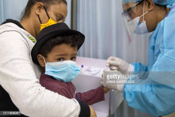 Boy has a rapid test for COVID-19 at the Regional University Hospital Doctor Luis Manuel Morillo King in La Vega, in the Dominican Republic, on May...