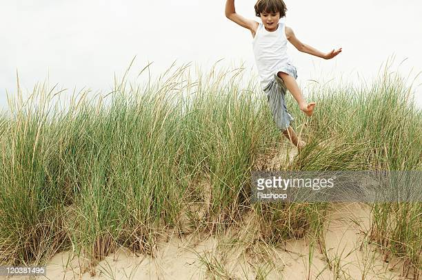 boy having a fun day out at the beach - children only stock pictures, royalty-free photos & images