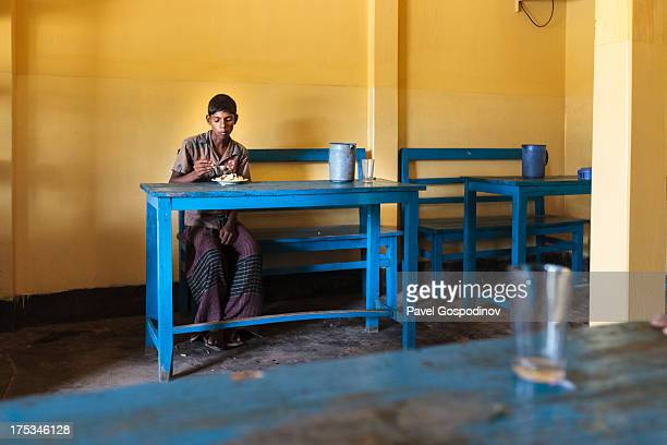 CONTENT] Boy having a lunch at a typical local bangladeshi restaurant in rural Bangladesh around Srimangal Indian SubContinent Asia