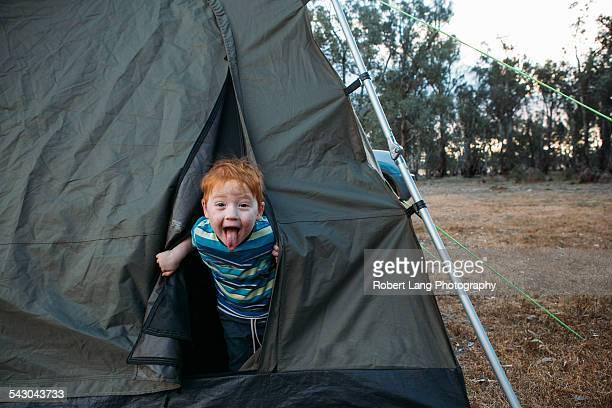 Boy having fun camping Australia