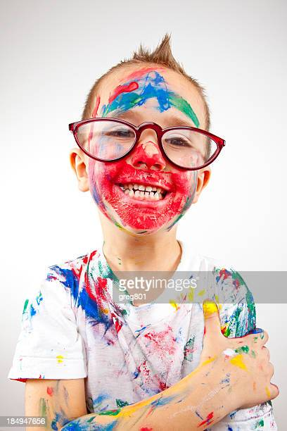 Boy having fun with finger paint