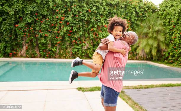 boy having fun with granny - grandmother stock pictures, royalty-free photos & images