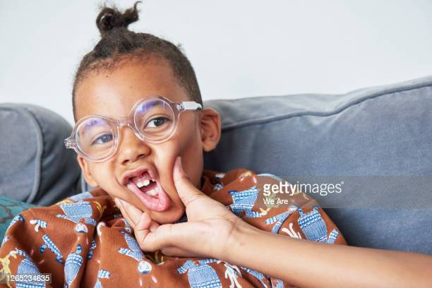 boy having his face squeezed in playful way - laughing stock pictures, royalty-free photos & images