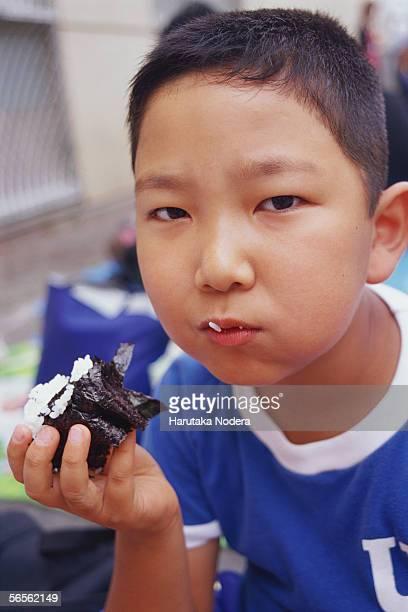 Boy having lunch on school sports day