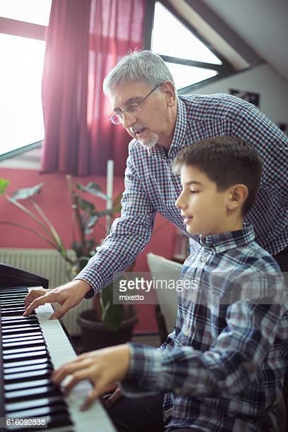 Boy having piano class
