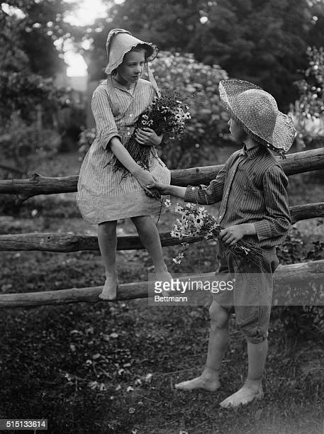 Boy Helping Girl Climb Off of Fence August 11 1925