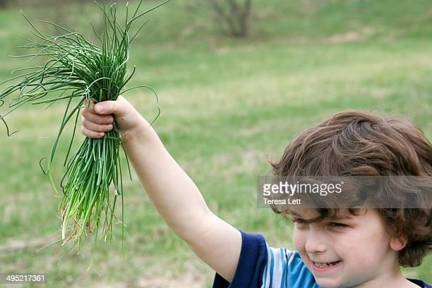 Boy helping in garden