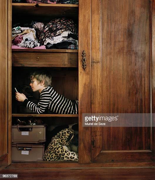 Boy hidding in wardrobe