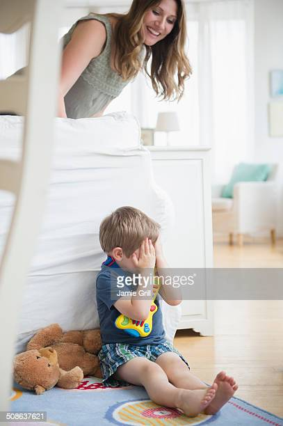 Boy hiding from mother
