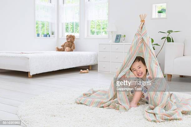 Boy Hiding In Tent