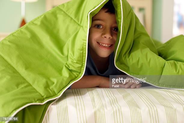 Boy Hiding Under Covers