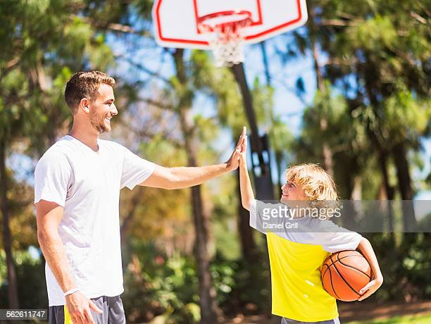 Boy (8-9) high fiving his brother