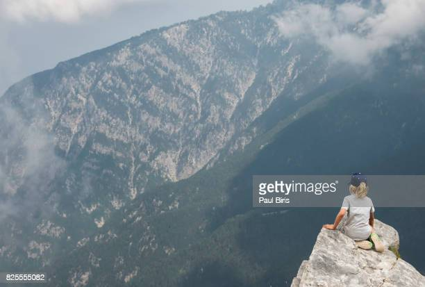 Boy  hiker looks off from high ridge crest, Mount Olympus, home of the gods of ancient Greece