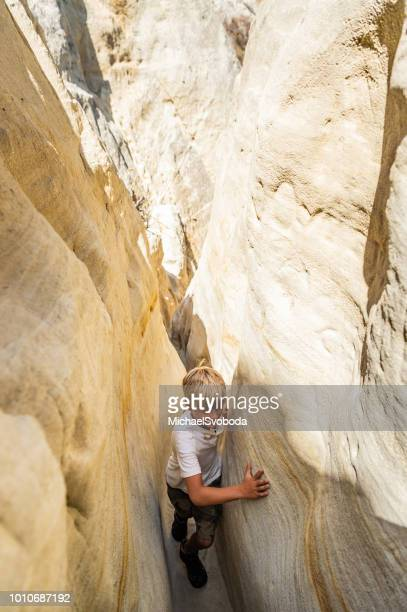 boy hiking through a canyon - narrow stock pictures, royalty-free photos & images