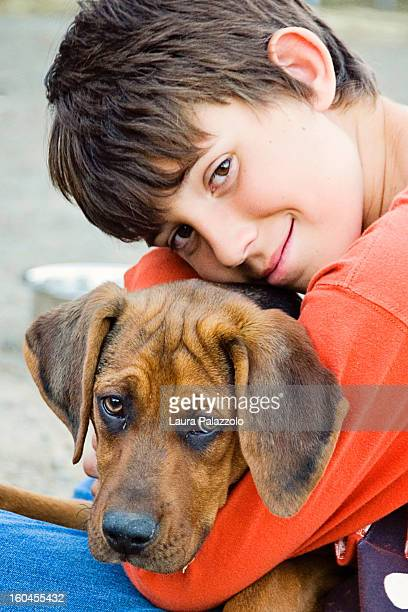 a boy & his dog - catahoula leopard dog stock pictures, royalty-free photos & images