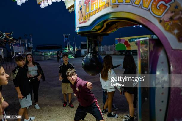 Boy hits the punching-ball in the funfair at Secca dei Pali in Molfetta on the occasion of the Patronal Festival on 10 September 2021. On the...