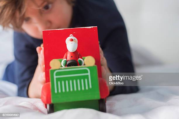 Boy holding a Christmas truck