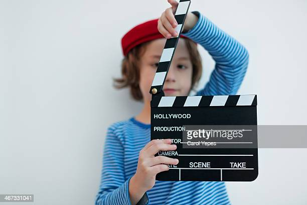 Boy holding a clapper board
