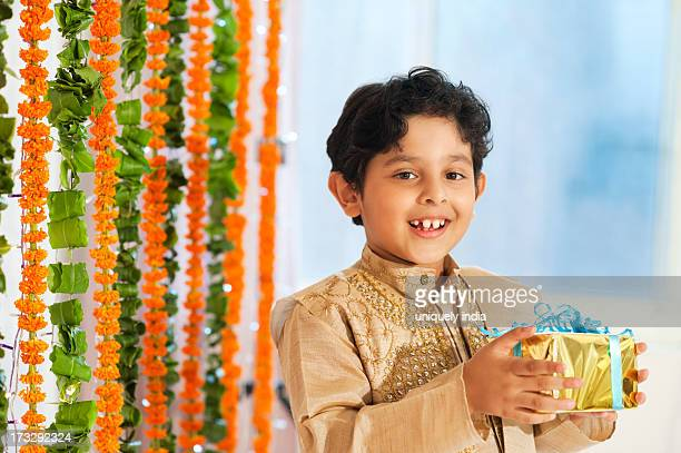 Boy holding a gift on Diwali