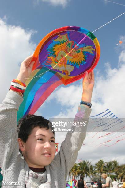 A boy holding a kite at the Kite Day Festival at Haulover Beach Park