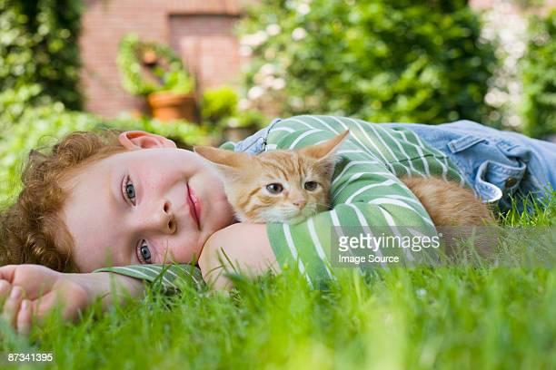 A boy holding a kitten