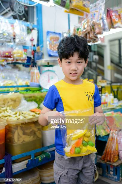 Boy holding a pack of assorted sweets and sour candies