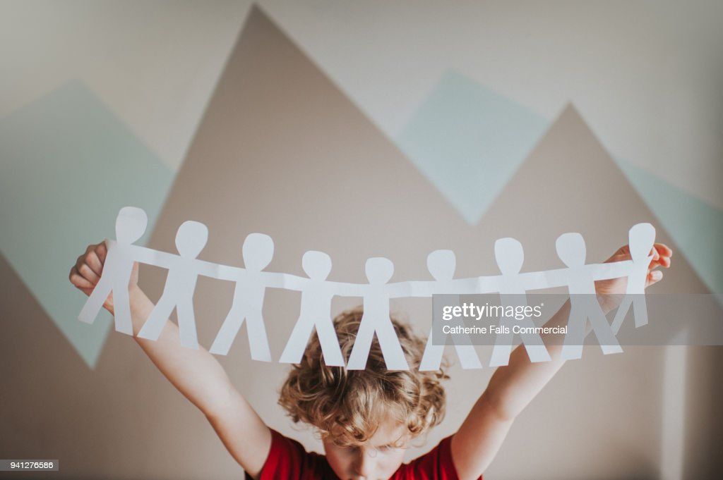 Boy holding a paper chain : Stock Photo