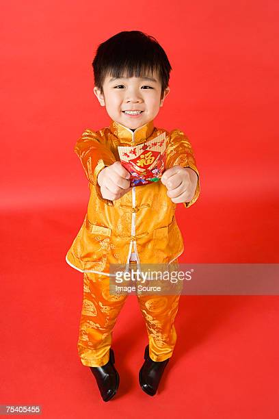 Boy holding a red packet